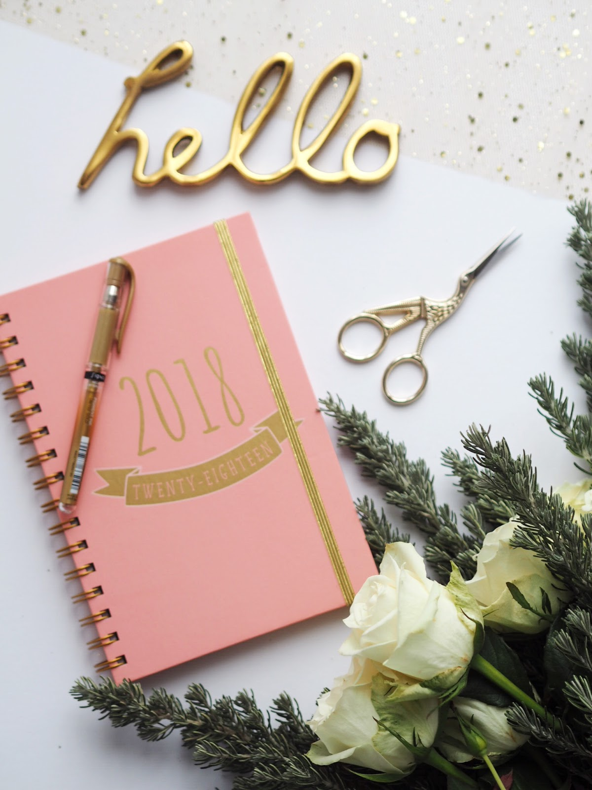 Lifestyle | Making 2018 My Best Year Yet - 2018 Planner, cut fresh white roses, spruce and hello letters