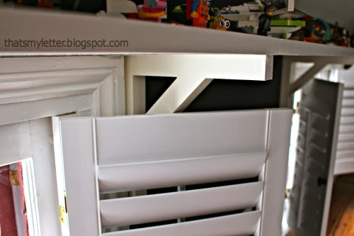 shutters open under shelf bracket