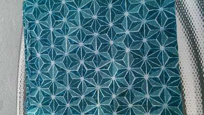 Cotton with diamond-shaped tiling pattern
