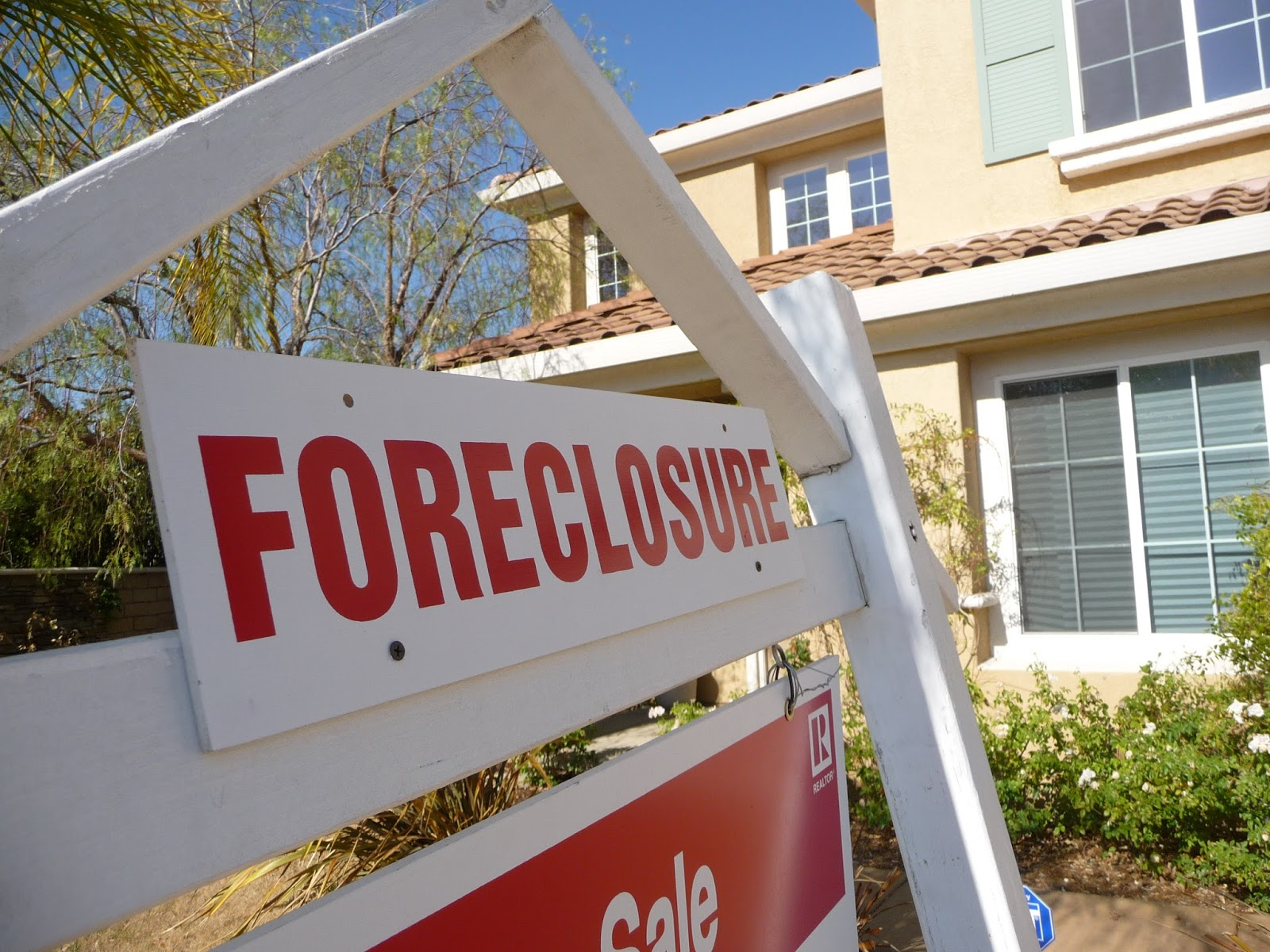foreclosure sign in front of house image