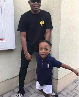 Olamide pose with his son