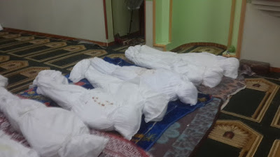 The victims in their coffins by Mohamed Khalil before their burial in the early hours of November 25