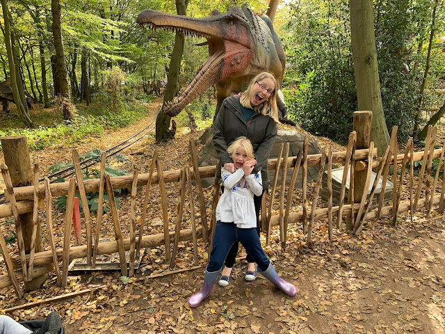 Me and my eldest posing scared in front of a moving dinosaur