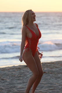 Jules Liesl models a Red Swimsuit