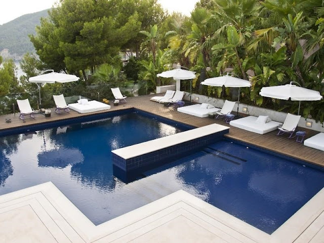 Swimming pool and the terrace with furniture