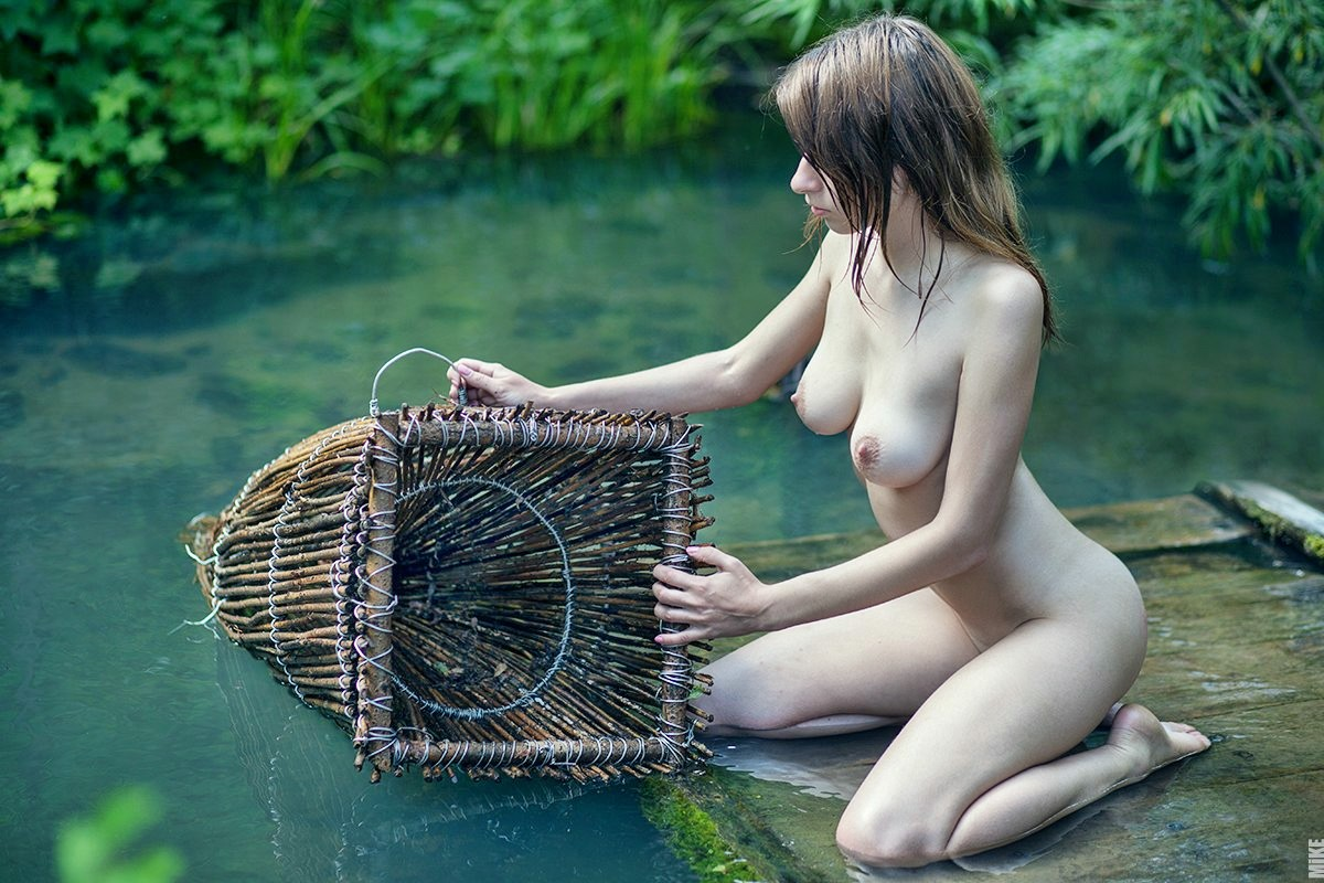 Sexy nude girl fishing