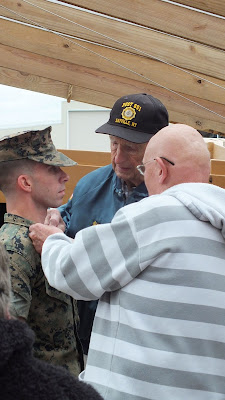 Marine Staff Sergeant Johnson receives collar insignia from grandfathers