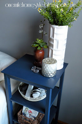 Navy blue side table with spring decor