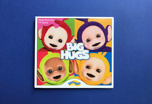 Front view of the Big Hugs CD cover showing the 4 Teletubbies