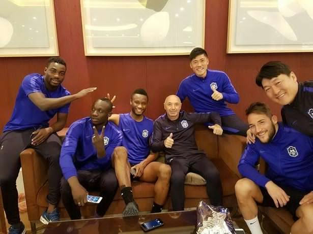 Mikel all smiles as he's pictured with Chinese club teammates