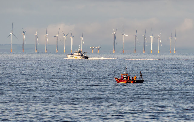 Photo of the local fisheries vessel and a small fishing boat on the Solway Firth