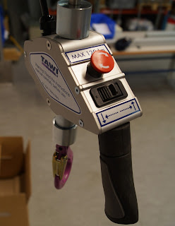 Hoist control buttons and joystick with hook