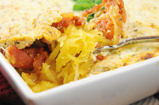 Baked Spaghetti Squash Gratin ~ Tender spaghetti squash topped with a quick-simmered tomato sauce & creamy, cheesy gratin topping.  So full of flavor you'll want to make it over and over!