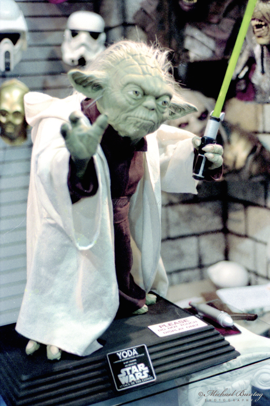 Star Wars Yoda PVC Figure, Comic-Con International, San Diego Convention Center, Marina District, San Diego, California. Nikon n90s SLR Body. Fujifilm NPZ800 color negative 35mm film.