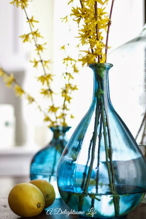 http://www.adelightsomelife.com/2014/03/blue-vases-forsythia-and-lemons.html