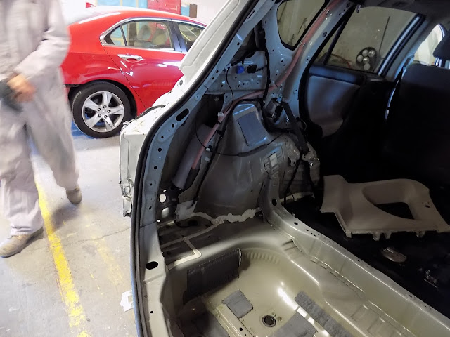 Close-up of interior disassembly and repairs on 2015 RAV4 at Almost Everything Auto Body.