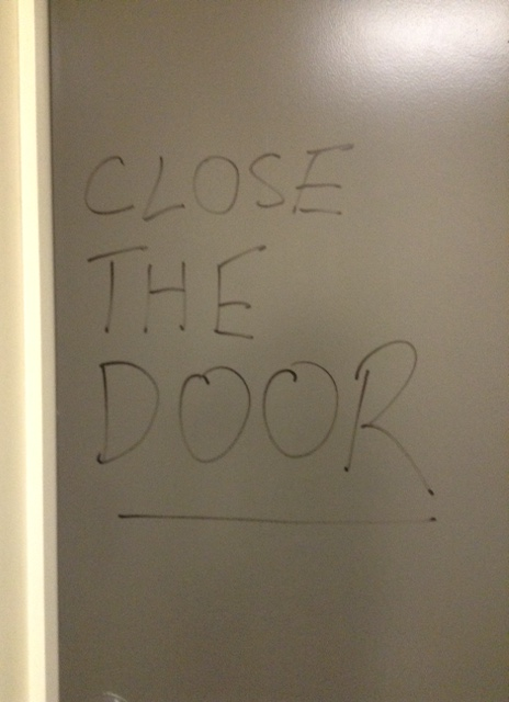 Written on the inside of the toilet door!