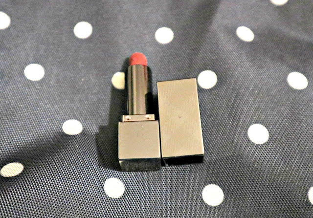 Burberry Lipstick on a polka dot background
