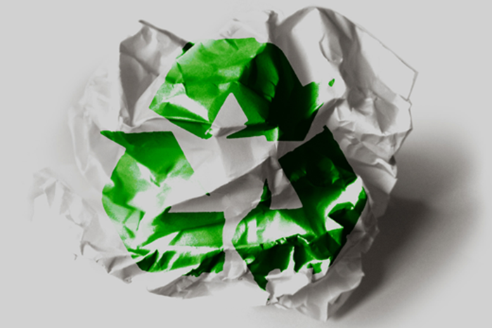 crumpled paper with green recycle icon