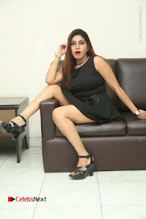 Tollywood Upcoming Actress Pooja Roshan Stills in Black Short Dress at Plus 1 Movie Trailer Launch  0329.JPG