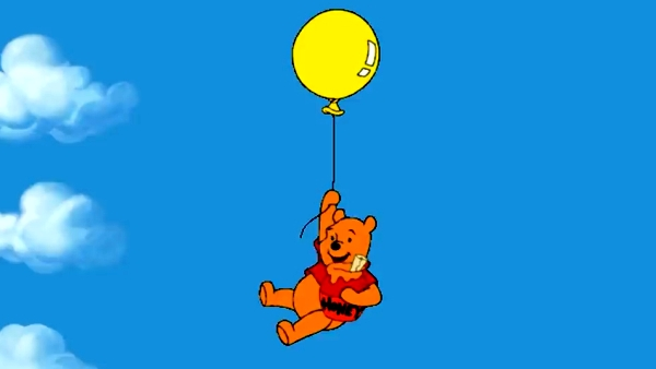 Pooh descending from the sky with a balloon singing