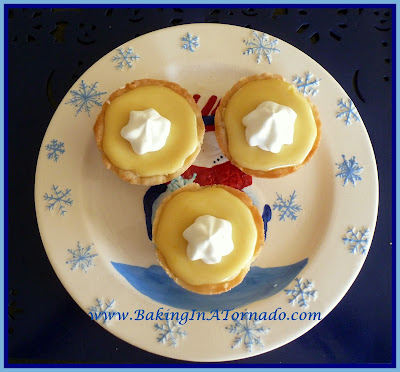 Lemon Raspberry Mini Pies | www.BakingInATornado.com | #recipe #pie