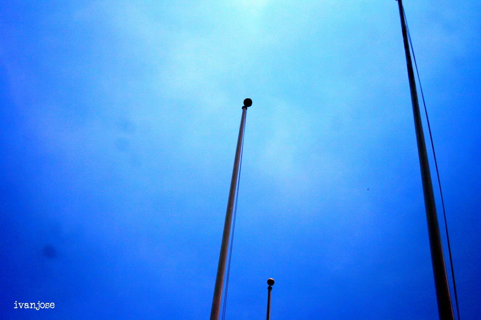 Flag poles at the harbor as we wait before boarding on the way to Grande Island Resort