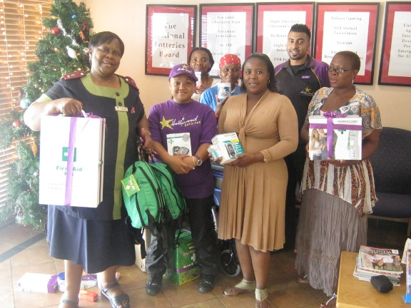The Hollywoodbets Lenz Station team pose with the staff at Soweto Hospice, and the donations made. - Social Responsibility - CSI