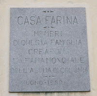 A wall plaque identifies Farina's birthplace in Santa Maria Maggiore