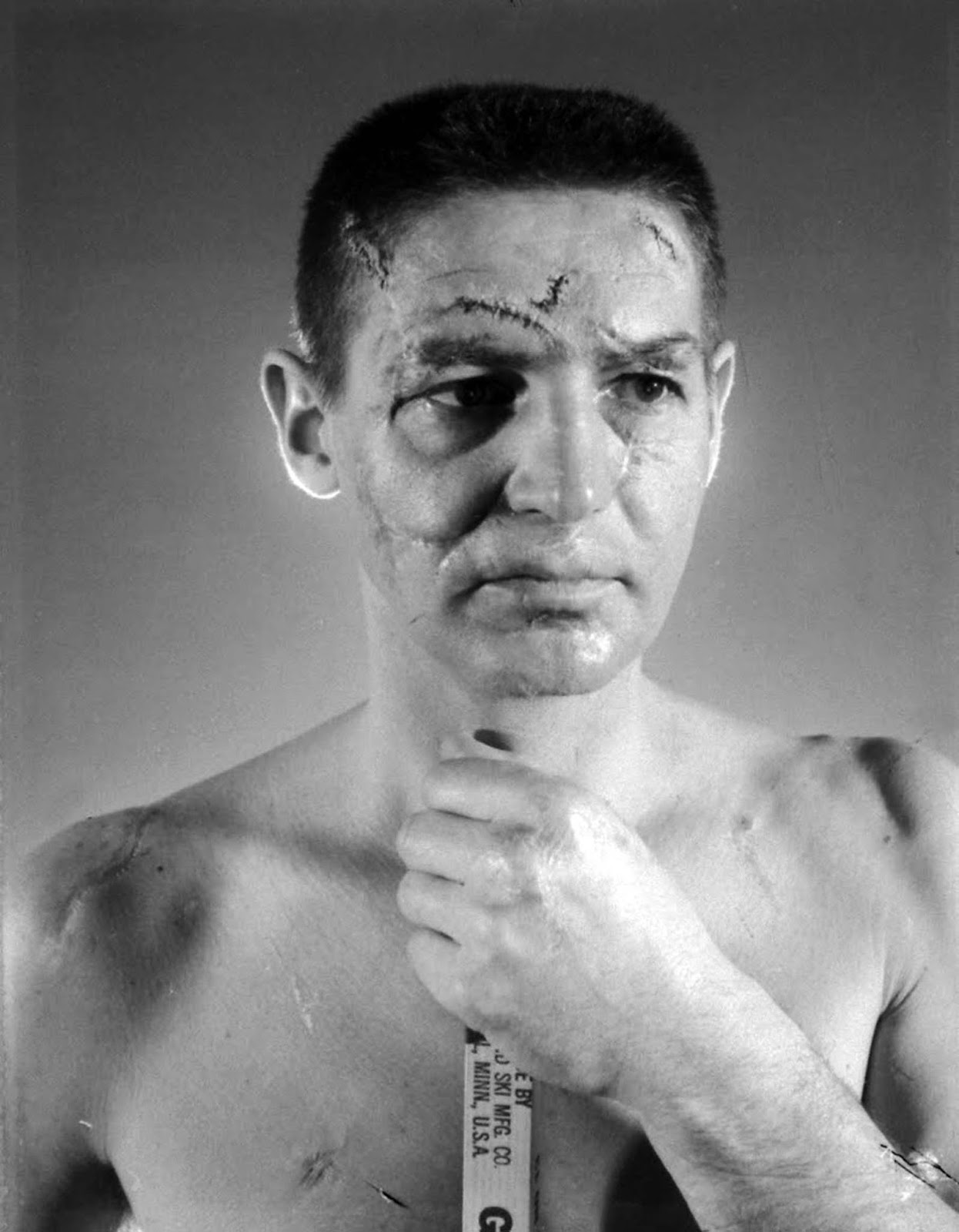 Terry Sawchuk, a face only a hockey puck could love.