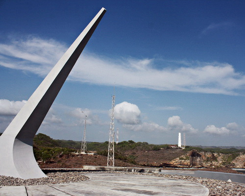 www.Tinuku.com Giant sundial overlooking Indian Ocean at cliff tops as Baron Technopark icons in hilly landscape Gunung Kidul
