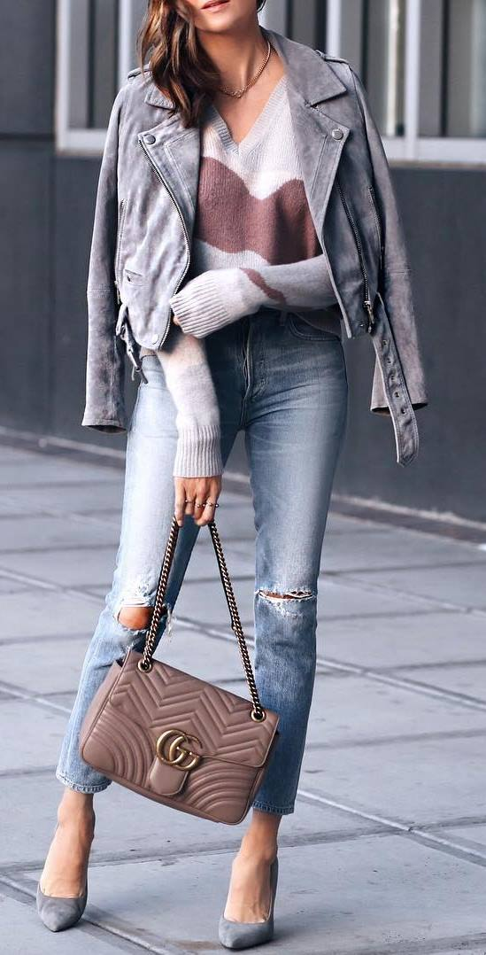 what to wear with a grey moto jacket : v neck sweater + heels + skinnies + bag