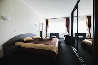 Кровать и номер в гостинице Sun Hotel Седата Игдеджи