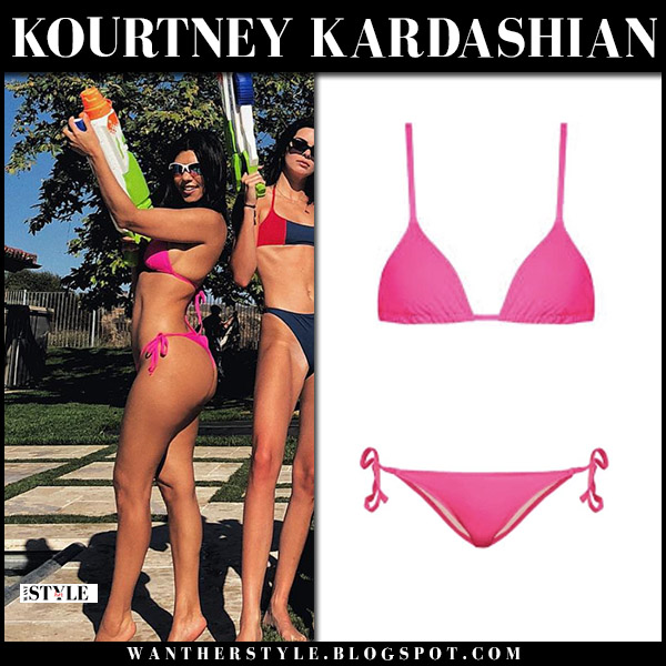 Kourtney Kardashian in pink bikini solid and striped beach style may 28