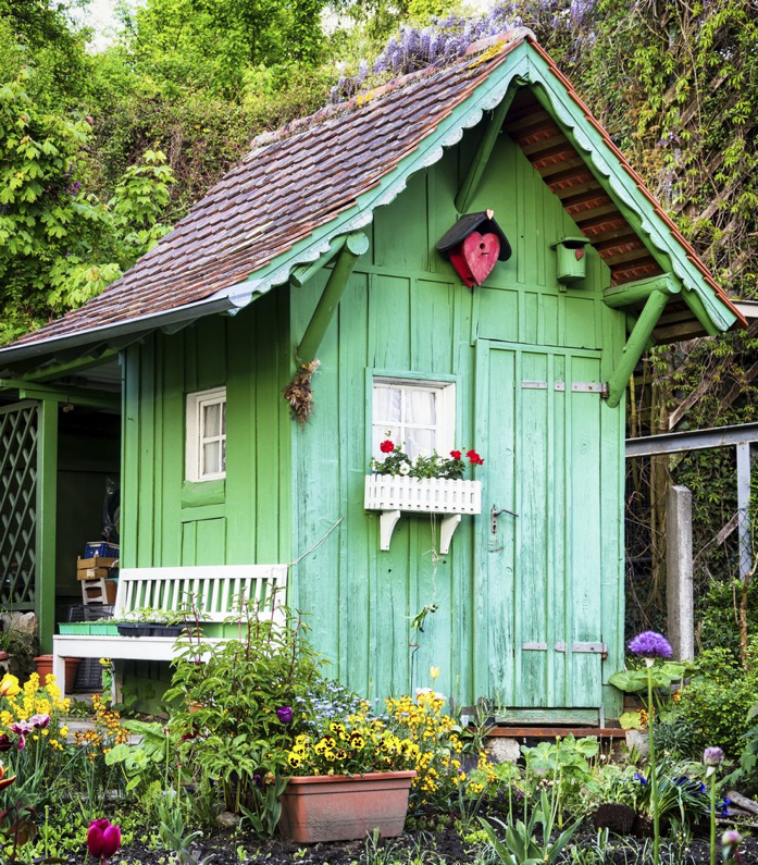Create your own she shed for Summer with colorful potted plants, window box planters, and paint.