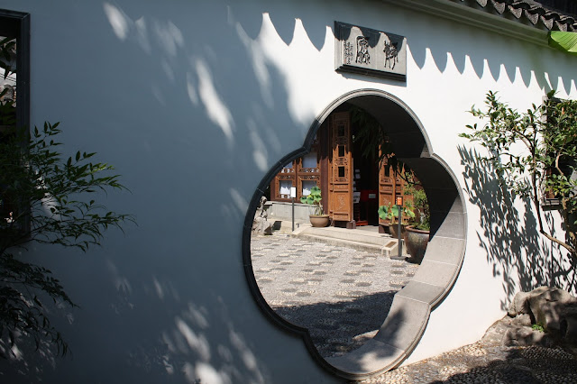 A peek inside the window invites you to step into tranquility at the Lan Su Chinese Garden in Portland, Oregon.