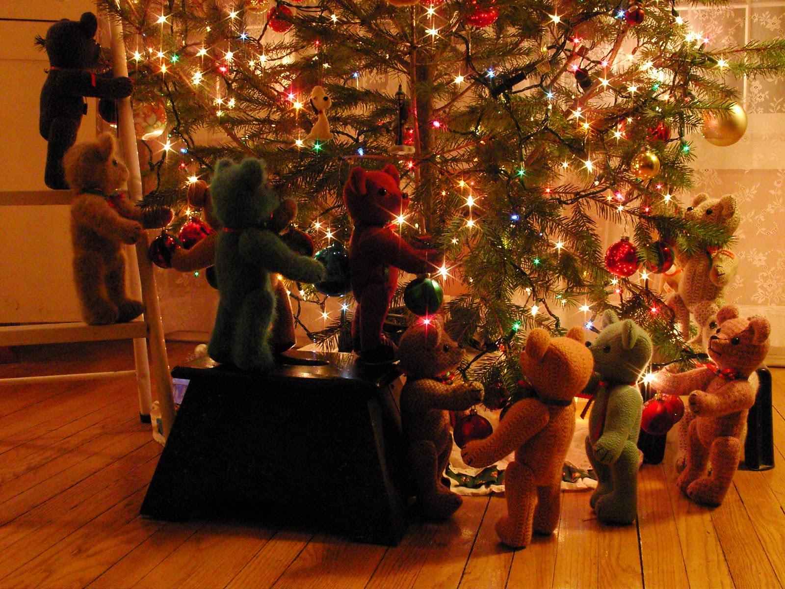 teddy bears help decorate the christmas tree