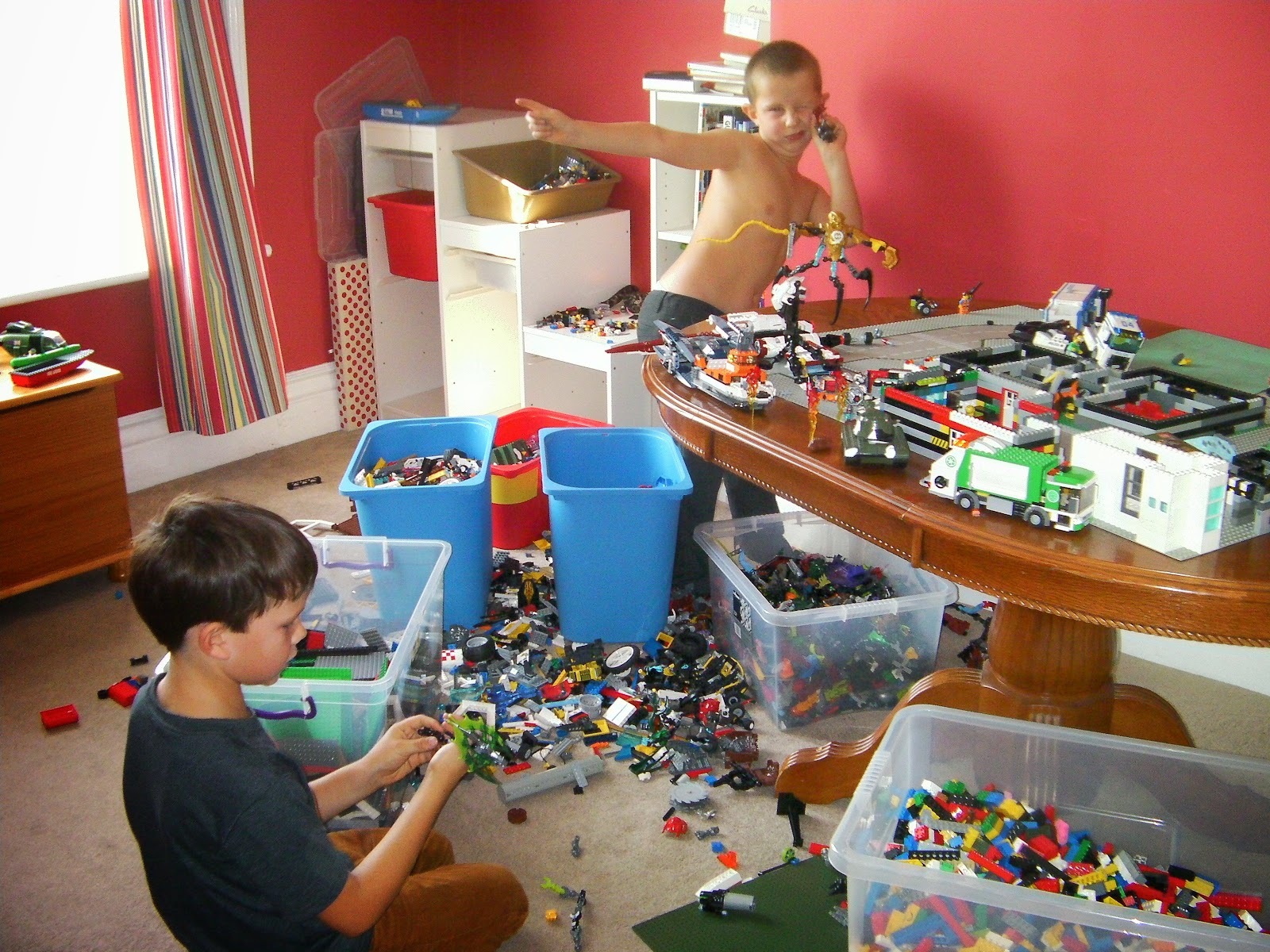 shirtless boy and giant lego collection boss from monsters inc