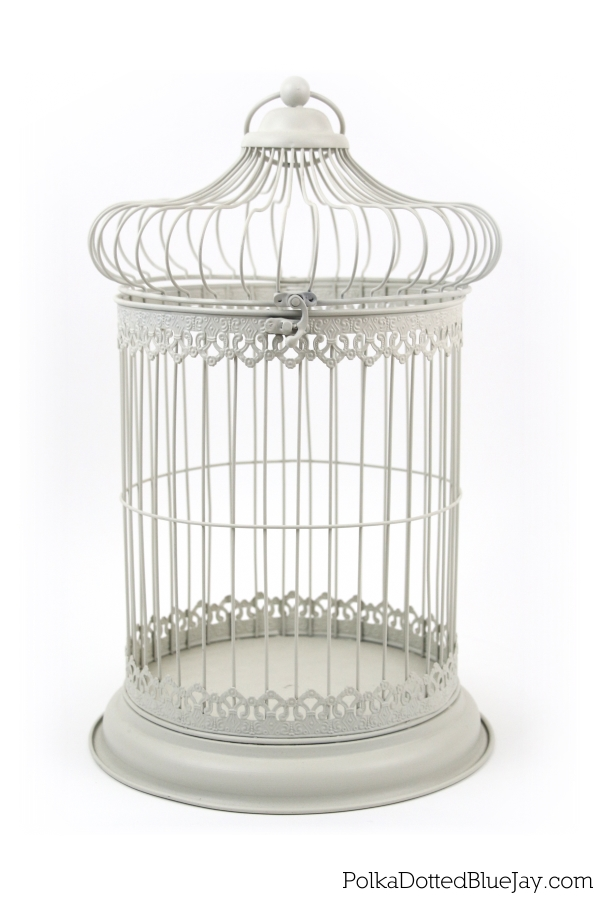 A birdcage is the perfect wedding card holder and this one is decorated with beautiful, hand-folded, flowers. Click here to see more.
