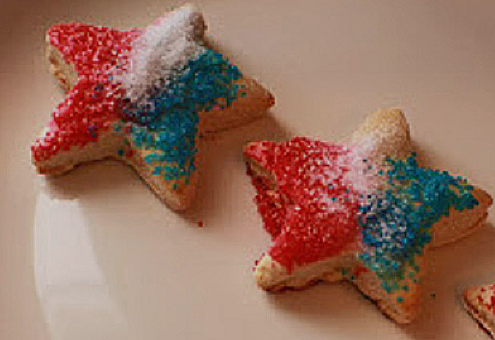 red white and blue sugars over loft cookies in star shapes for the 4th of July or Memorial Day Parties