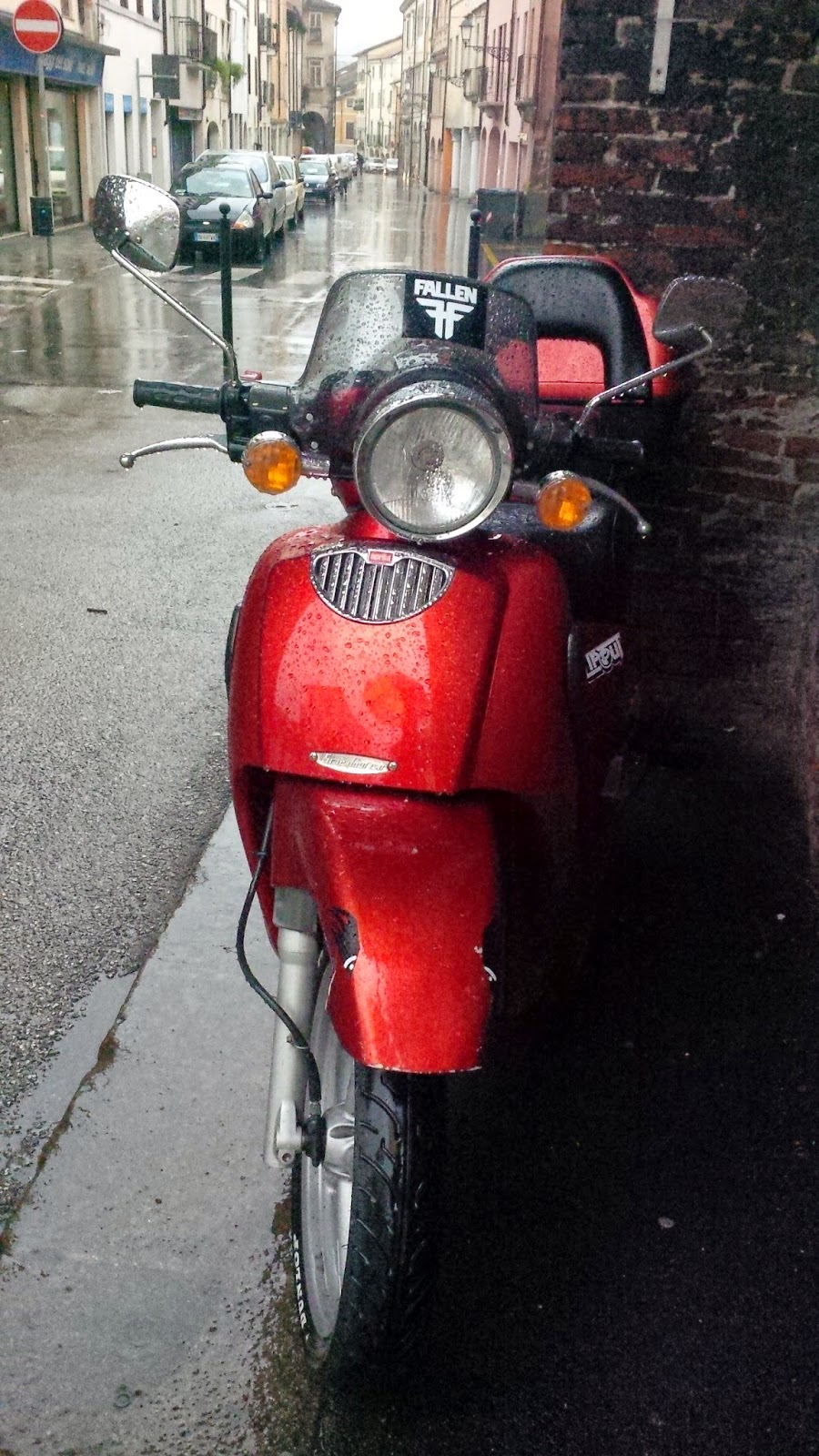 red moped wet with rain streets of Vicenza