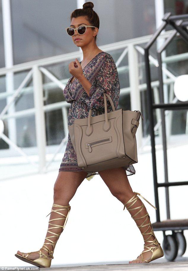 8adc91501c1 Kourtney Kardashian flaunts kimono style mini dress with Chanel gold gladiator  sandals