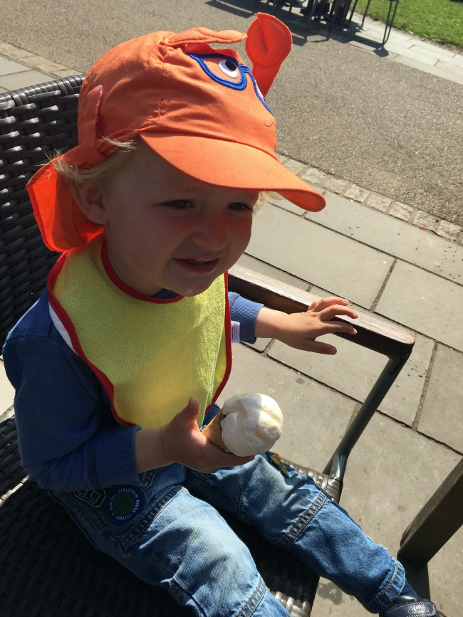 toddler-sat-in-sunshine-with-an-ice-cream