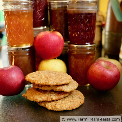 pic of apple butter muffin top cookies with jars of jam and apple butter