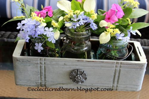 Painted sewing drawer wiht mason jars and flowers