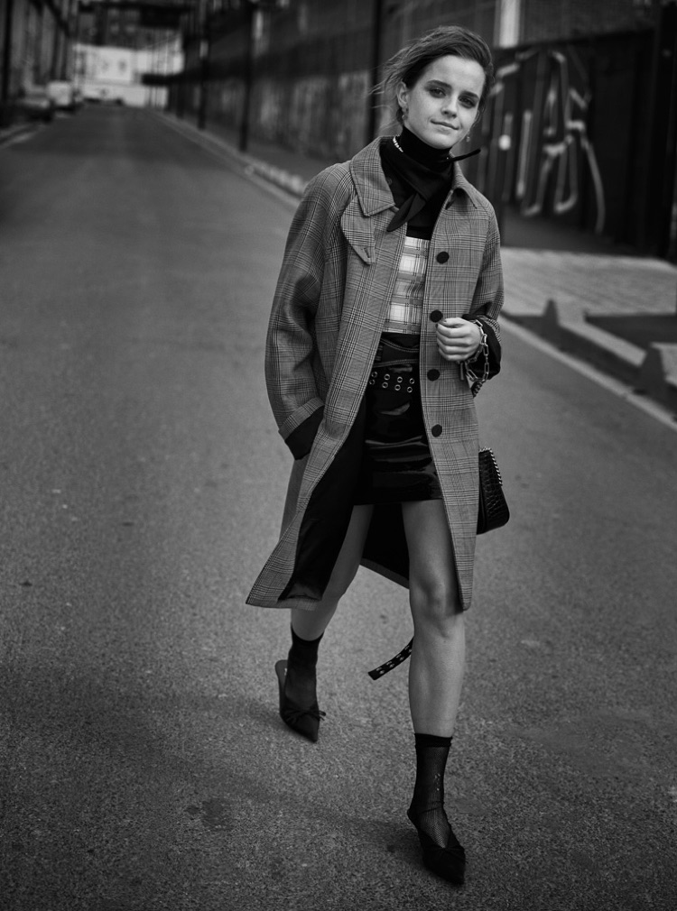 Emma Watson poses in Louis Vuitton coat, Prada top and UNIF skirt