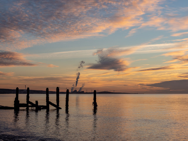 Photo of the old groyne on Maryport beach at sunset
