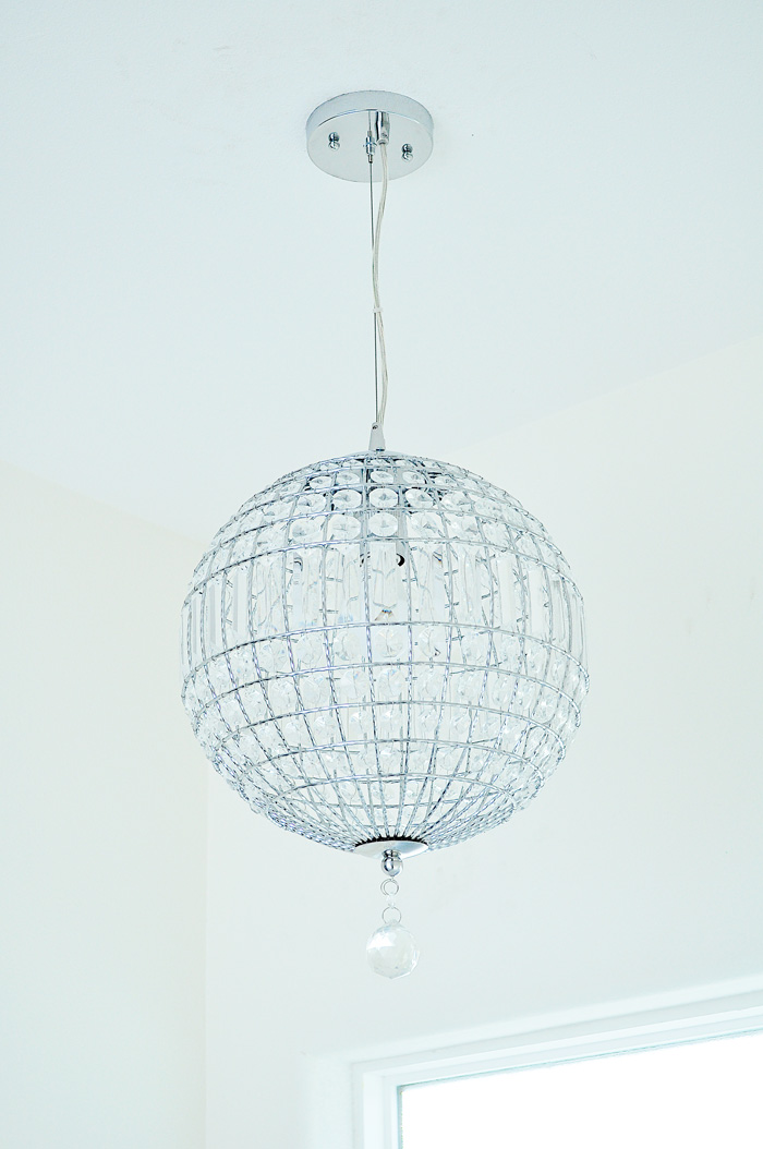 Possini Casey Crystal Globe Chandelier Pendant Light: Our lighting choices for our new home. Learn how we saved $1000. | via monicawantsit.com
