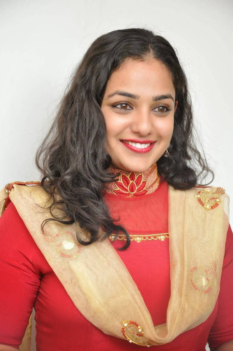 Telugu Girl Nithya Menen Hot Beautiful Smiling Face Close Up Photos In Red Dress