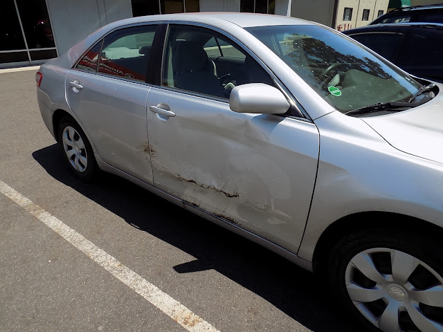 Damaged Camry before collision repair at Almost Everything Auto Body.